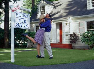 Xcouple-with-sold-sign